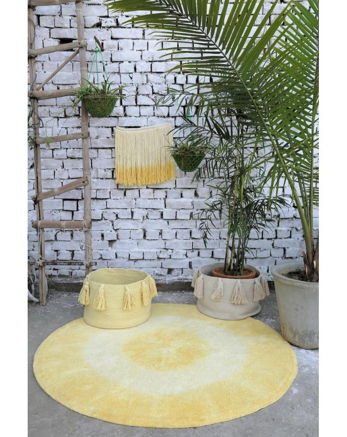 Geltonas apvalus skalbiamas kilimas